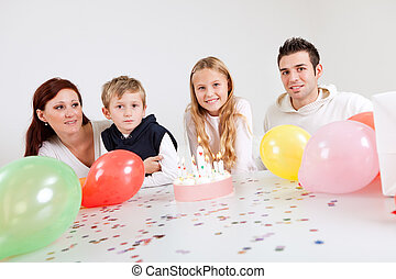 Young family celebrating birthday at home