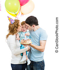 young family celebrating first baby birtday