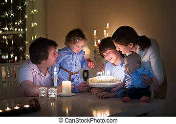 Young family celebrating the birthday of their son