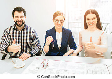 Young family couple purchase rent property real estate . Agent giving consultation to man and woman. Signing contract for buying house or flat or apartments