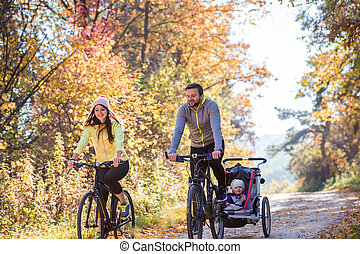 Young family cycling