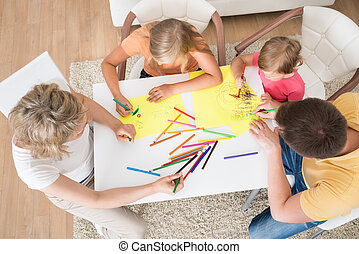 Young Family Drawing Together With Kids