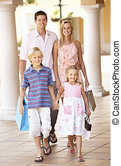 Young Family Enjoying Shopping Trip Together