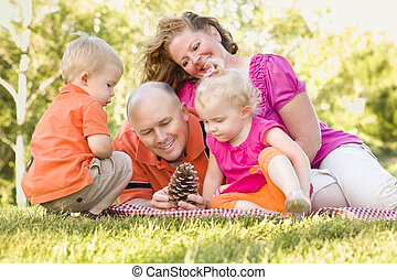 Young Family Enjoying The Park Together