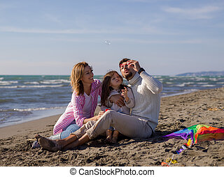 Young family enjoying vecation during autumn day