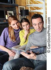 Young family going through photo album