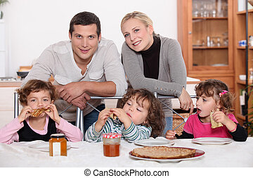 Young family having breakfast