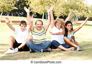 Young family having fun in park