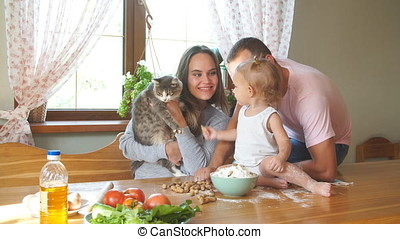 Young family having fun in the kitchen.