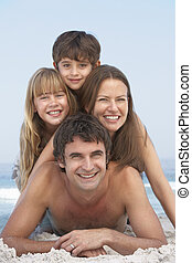 Young Family Having Fun On Beach Holiday