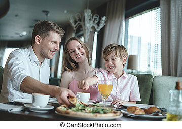 Young family having lunch