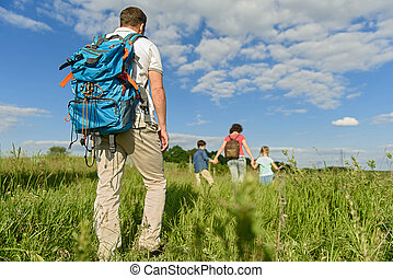 Young family hiking on mountain