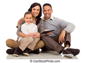 young family holding tablet computer
