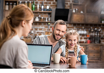 Young family in kitchen
