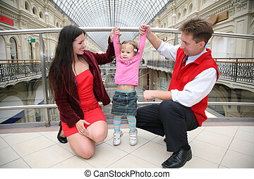 young family in Moscow universal store