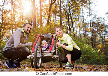 Young family in nature - Beautiful young family with baby in...