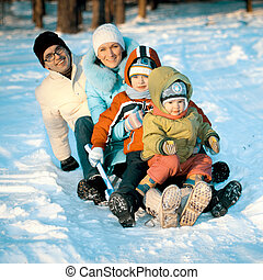 Young Family In Snow Scene