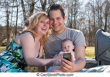 Young family is taking a picture with the smartphone