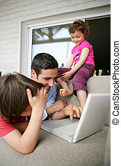 Young family looking at a laptop