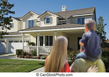 Young Family Looking at a New Home
