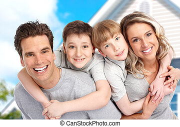 Young family near the new home. Real estate concept