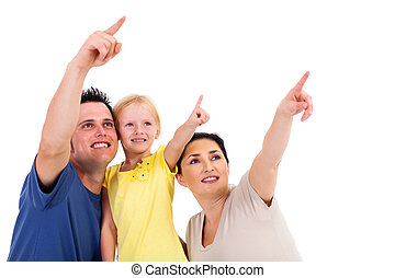young family of three pointing