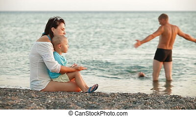 Young Family on a Summer Beach