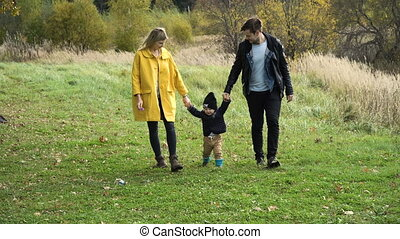 Young family on a walk in the park.
