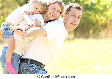 Young family on nature
