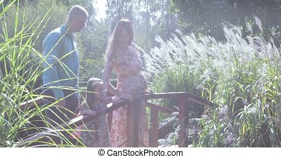 Young family on the wooden bridge