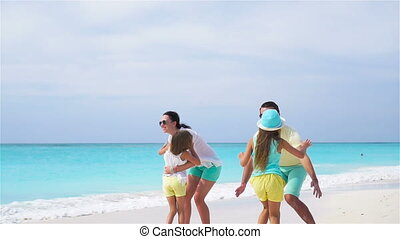Young family on vacation have a lot of fun on the beach. Slow motion.
