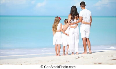 Young family on vacation on caribbean beach