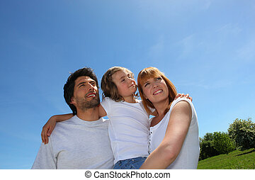 Young family outdoors on a sunny day