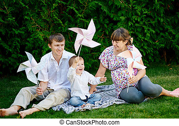 Young family playing at a picnic in the park
