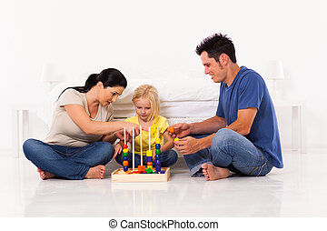 young family playing with educational toy