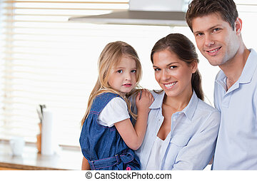 Young family posing