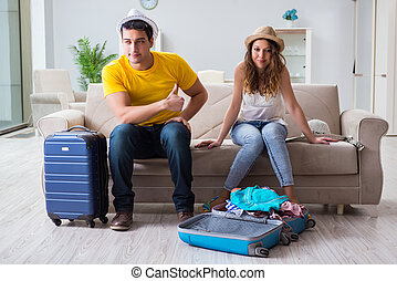 Young family preparing for travel vacation