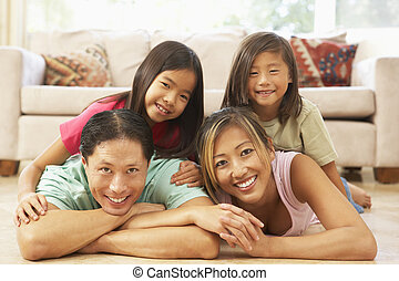 Young Family Relaxing At Home