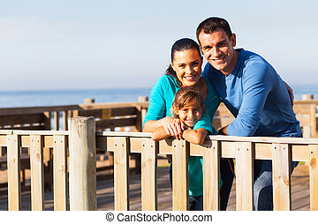 young family relaxing at the beach