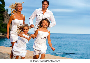 Young family running together.