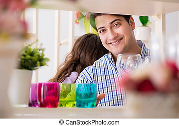 Young family shopping in shop
