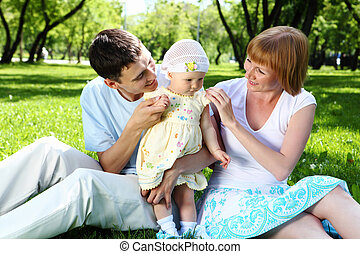 Young family together in the park