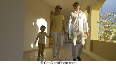 Young Family Walking over the Passage