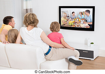 Young Family Watching TV Together