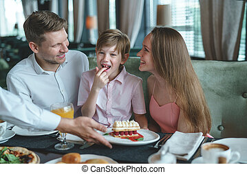 Young family with child at a dinner