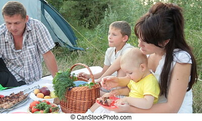 Young family with children spending weekend on the nature
