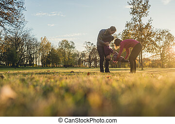 Young family with two kids having fun in a park