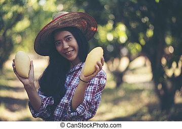 young farmer enjoy with mango
