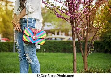 Young fashion business woman with handbag