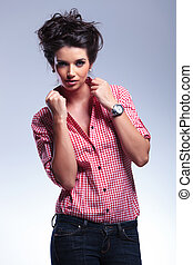 young fashion casual woman pulling her collar